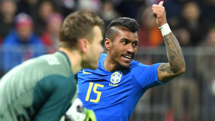 Brazil's midfielder Paulinho gestures during an international friendly football match between Russia and Brazil at the Luzhniki stadium in Moscow on March 23, 2018. / AFP PHOTO / Kirill KUDRYAVTSEV        (Photo credit should read KIRILL KUDRYAVTSEV/AFP/Getty Images)