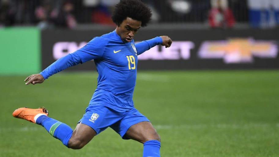 Brazil's midfielder Willian shoots the ball during an international friendly football match between Russia and Brazil at the Luzhniki stadium in Moscow on March 23, 2018. / AFP PHOTO / Alexander NEMENOV        (Photo credit should read ALEXANDER NEMENOV/AFP/Getty Images)