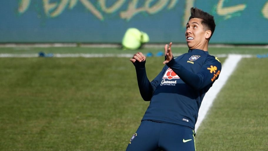 Brazil's forward Roberto Firmino (R) attends a training session of the Brazilian team ahead of their friendly football match Germany vs Brazil in Berlin, Germany, on March 25, 2018, in preparation of the 2018 Fifa World Cup. Germany plays against Brazil on March 27, 2018. / AFP PHOTO / Odd ANDERSEN        (Photo credit should read ODD ANDERSEN/AFP/Getty Images)