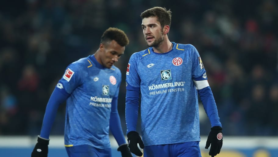HANOVER, GERMANY - JANUARY 13:  (L-R) Jean Philippe Gbamin and Stefan Bell of Mainz  appears frustrated after the Bundesliga match between Hannover 96 and 1. FSV Mainz 05 at HDI-Arena on January 13, 2018 in Hanover, Germany.  (Photo by Oliver Hardt/Bongarts/Getty Images)