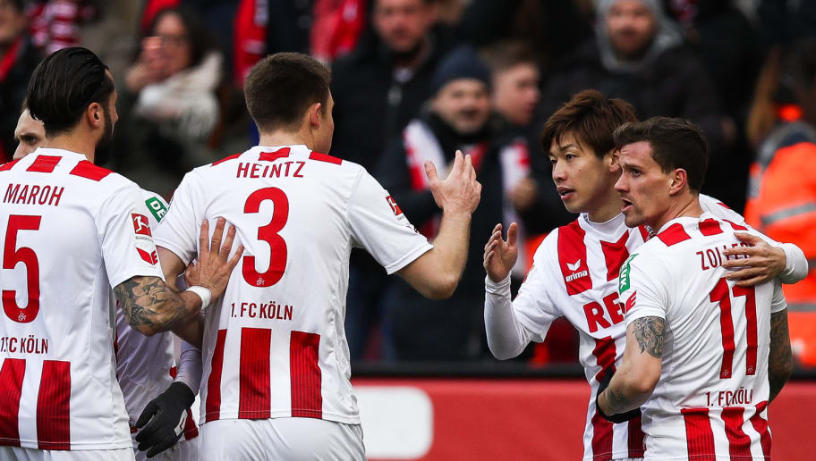 COLOGNE, GERMANY - MARCH 18: Yuya Osako #13 of 1.FC Koeln celebrates with Simon Zoller #11 of 1.FC Koeln and team-mates after scoring his teams first goal during the Bundesliga match between 1. FC Koeln and Bayer 04 Leverkusen at RheinEnergieStadion on March 18, 2018 in Cologne, Germany. (Photo by Maja Hitij/Bongarts/Getty Images)