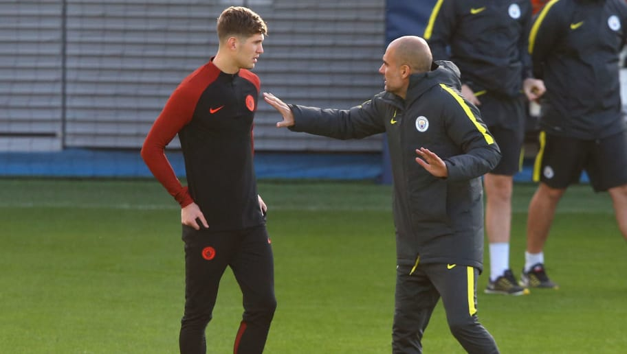 MANCHESTER, ENGLAND - OCTOBER 18:  Pep Guardiola the manager of Manchester City talks with John Stones during a training session at City Academy on October 18, 2016 in Manchester, England.  (Photo by Alex Livesey/Getty Images)