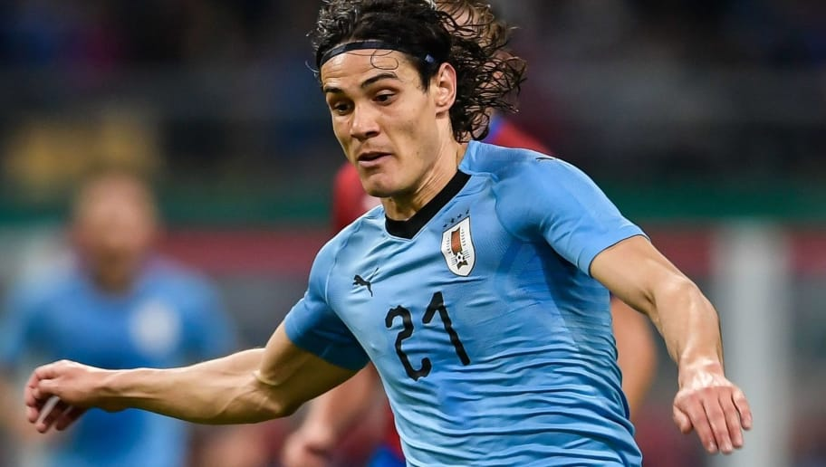Edinson Cavani of Uruguay runs with the ball during their China Cup International Football Championship Semi-final match against Czech in Nanning in China's southern Guangxi region on March 23, 2018. / AFP PHOTO / - / China OUT        (Photo credit should read -/AFP/Getty Images)
