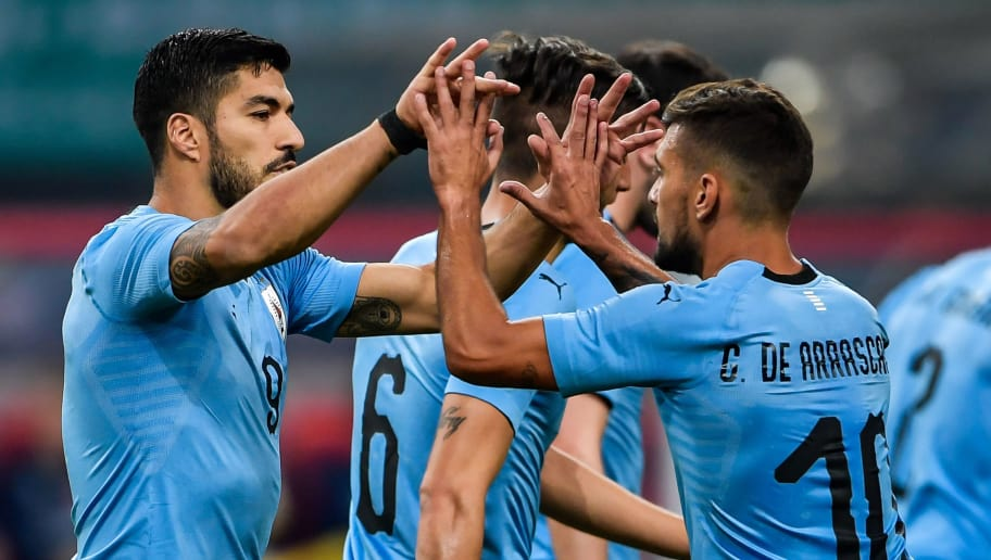 Luis Suarez (L) of Uruguay celebrates with teammate Giorian De Arrascaeta (R, #10) during their China Cup International Football Championship Semi-final match against Czech in Nanning in China's southern Guangxi region on March 23, 2018. / AFP PHOTO / - / China OUT        (Photo credit should read -/AFP/Getty Images)