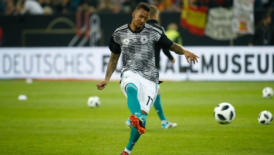 Germany's defender Jerome Boateng warms up with the ball prior to the international friendly football match of Germany vs Spain in Duesseldorf, western Germany, on March 23, 2018, in preparation of the 2018 Fifa World Cup. / AFP PHOTO / Odd ANDERSEN        (Photo credit should read ODD ANDERSEN/AFP/Getty Images)