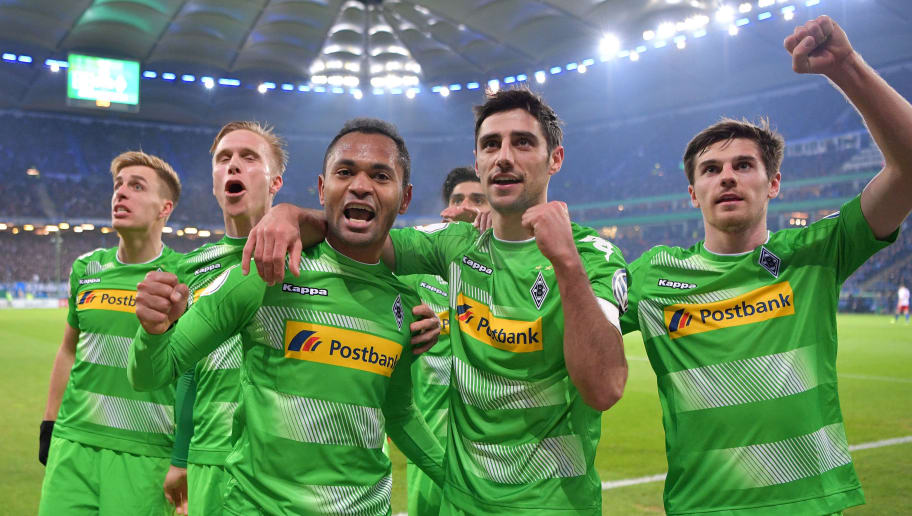 HAMBURG, GERMANY - MARCH 01:  (left) Raffaelof Gladbach celebrates scoring thes econd goal with the first goal scorer Lars Stindl (center) and Jonas Hofmann (right) during the DFB Cup quarter final between Hamburger SV and Borussia Moenchengladbach at Volksparkstadion on March 1, 2017 in Hamburg, Germany.  (Photo by Stuart Franklin/Bongarts/Getty Images)