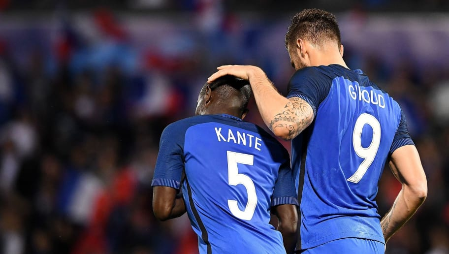 France's midfielder N'Golo Kante (L) congratulates France's forward Olivier Giroud duirng the friendly football match between France and Scotland, at the St Symphorien Stadium in Longeville-lès-Metz, Eastern France, on June 4, 2016.  / AFP / FRANCK FIFE        (Photo credit should read FRANCK FIFE/AFP/Getty Images)