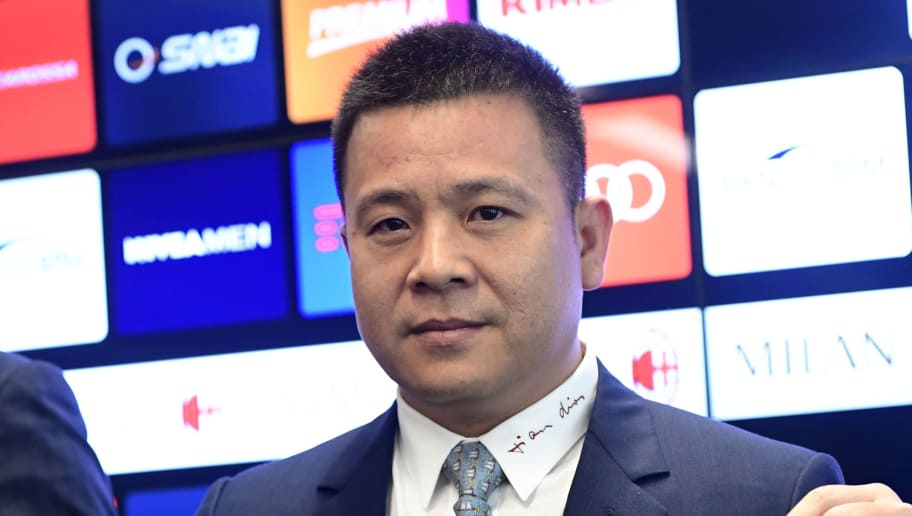 Head of Rossoneri Sport Investment Lux, Chinese businessman and new owner of the AC Milan football club, Yonghong Li poses with a jersey of the club during a press conference on April 14, 2017 in Milan.  Serie A giants AC Milan were sold to Rossoneri Sport Investment Lux yesterday in a deal which sees the Chinese-led consortium take a 99.9% stake in the club. The seven-time European champions who are Italy's most succcessful club in international competition, have been owned by former three-time Italy prime minister Silvio Berlusconi since 1986. A joint statement by AC Milan's holding company Fininvest and Rossoneri Sport Investment Lux said on April 13, 2017 : 'Today Fininvest has completed the sale of the entire stake owned in AC Milan - equal to 99.93% - to Rossoneri Sport Investment Lux.'  / AFP PHOTO / Miguel MEDINA        (Photo credit should read MIGUEL MEDINA/AFP/Getty Images)