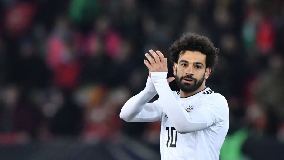 Egypt's forward Mohamed Salah applauds during an international friendly football match between Portugal and Egypt at Letzigrund stadium in Zurich on March 23, 2018. / AFP PHOTO / Fabrice COFFRINI        (Photo credit should read FABRICE COFFRINI/AFP/Getty Images)