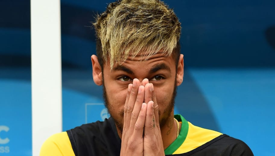 BRASILIA, BRAZIL - JULY 12: An injured Neymar of Brazil looks on from the bench during the 2014 FIFA World Cup Brazil Third Place Playoff match between Brazil and the Netherlands at Estadio Nacional on July 12, 2014 in Brasilia, Brazil.  (Photo by Buda Mendes/Getty Images)
