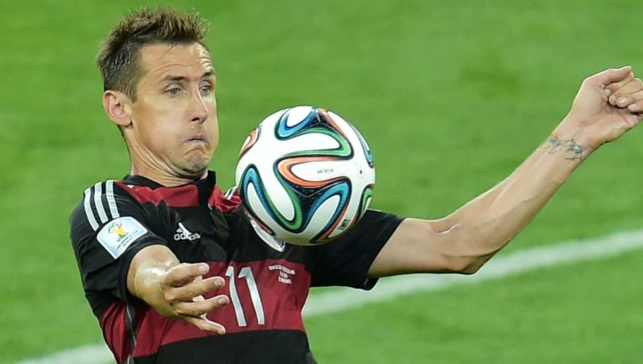 Germany's forward Miroslav Klose controls the ball during the semi-final football match between Brazil and Germany at The Mineirao Stadium in Belo Horizonte during the 2014 FIFA World Cup on July 8, 2014. AFP PHOTO / GABRIEL BOUYS        (Photo credit should read GABRIEL BOUYS/AFP/Getty Images)