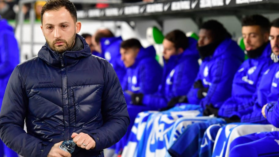 Schalke's German headcoach Domenico Tedesco arrives on the pitch prior to the German First division Bundesliga football match VfL Wolfsburg vs Schalke 04, in Wolfsburg, on March 17, 2018. / AFP PHOTO / John MACDOUGALL / RESTRICTIONS: DURING MATCH TIME: DFL RULES TO LIMIT THE ONLINE USAGE TO 15 PICTURES PER MATCH AND FORBID IMAGE SEQUENCES TO SIMULATE VIDEO. == RESTRICTED TO EDITORIAL USE == FOR FURTHER QUERIES PLEASE CONTACT DFL DIRECTLY AT + 49 69 650050  / RESTRICTIONS: DURING MATCH TIME: DFL RULES TO LIMIT THE ONLINE USAGE TO 15 PICTURES PER MATCH AND FORBID IMAGE SEQUENCES TO SIMULATE VIDEO. == RESTRICTED TO EDITORIAL USE == FOR FURTHER QUERIES PLEASE CONTACT DFL DIRECTLY AT + 49 69 650050        (Photo credit should read JOHN MACDOUGALL/AFP/Getty Images)