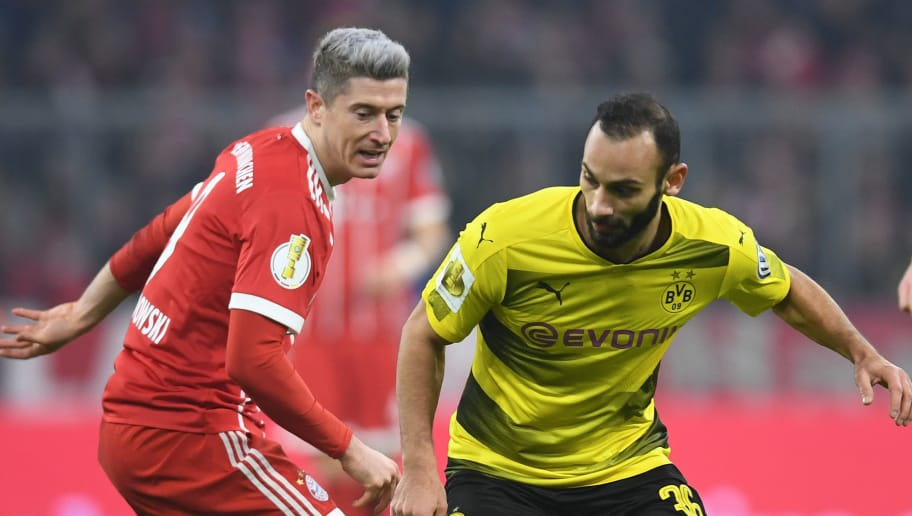 Bayern Munich's Polish striker Robert Lewandowski (L) and Dortmunds Turkish defender Omer Toprak (R) vie for the ball during the German football Cup DFB Pokal round of sixteen match Bayern Munich vs Borussia Dortmund in Munich, southern Germany, on December 20, 2017.  / AFP PHOTO / CHRISTOF STACHE        (Photo credit should read CHRISTOF STACHE/AFP/Getty Images)