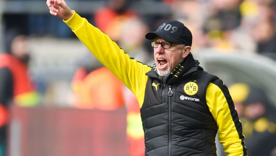 Dortmund's German headcoach Peter Stoeger reacts during the German first division Bundesliga football match Borussia Dortmund vs Hanover 96, in Dortmund, western Germany, on March 18, 2018. / AFP PHOTO / Patrik STOLLARZ / RESTRICTIONS: DURING MATCH TIME: DFL RULES TO LIMIT THE ONLINE USAGE TO 15 PICTURES PER MATCH AND FORBID IMAGE SEQUENCES TO SIMULATE VIDEO. == RESTRICTED TO EDITORIAL USE == FOR FURTHER QUERIES PLEASE CONTACT DFL DIRECTLY AT + 49 69 650050         (Photo credit should read PATRIK STOLLARZ/AFP/Getty Images)