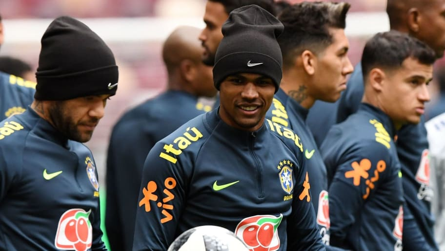 From L: Brazil's defender Dani Alves, forward Douglas Costa, forward Firmino and midfielder Philippe Coutinho take part in a training session at the Luzhniki stadium in Moscow on March 22, 2018, on the eve of a friendly football match between Russia and Brazil. / AFP PHOTO / Kirill KUDRYAVTSEV        (Photo credit should read KIRILL KUDRYAVTSEV/AFP/Getty Images)
