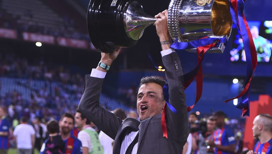 TOPSHOT - Barcelona's coach Luis Enrique holds up the cup after the team won the Spanish Copa del Rey (King's Cup) final football match FC Barcelona vs Deportivo Alaves at the Vicente Calderon stadium in Madrid on May 27, 2017. Barcelona won 3-1. / AFP PHOTO / Josep LAGO        (Photo credit should read JOSEP LAGO/AFP/Getty Images)