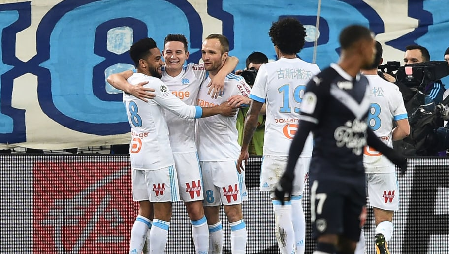 Olympique de Marseille's French midfielder Florian Thauvin (2nd-L) celebrates with Marseille's French forward Valere Germain (3rd-L) and Marseille's French midfielder Morgan Sanson (1st-L) during the French L1 football match Marseille vs Bordeaux on February 18, 2018, at the Velodrome stadium in Marseille, Southern France. / AFP PHOTO / ANNE-CHRISTINE POUJOULAT        (Photo credit should read ANNE-CHRISTINE POUJOULAT/AFP/Getty Images)