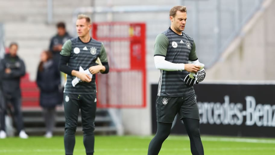 HAMBURG, GERMANY - OCTOBER 05: Manuel Neuer (R) of Germany looks on with Marc-Andre ter Stegen during a training session at Millerntor Stadion on October 5, 2016 in Hamburg, Germany.  (Photo by Martin Rose/Bongarts/Getty Images)