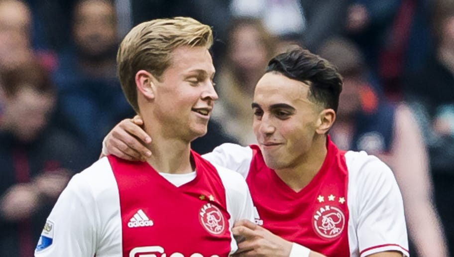 Ajax's Dutch midfielder Abdelhak Nouri (R) and Frenkie de Jong react during a football match in Amsterdam on May 7, 2017.    Abdelhak Nouri has suffered 'serious and permanent' brain damage following his collapse over the weekend, his club Ajax said on July 13, dashing earlier hopes the promising prospect would make a quick recovery. / AFP PHOTO / ANP / ERIK PASMAN / Netherlands OUT        (Photo credit should read ERIK PASMAN/AFP/Getty Images)