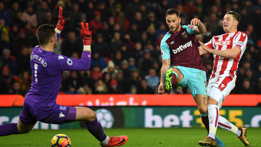 STOKE ON TRENT, ENGLAND - DECEMBER 16: Marko Arnautovic of West Ham United scores his sides second goal pat Jack Butland of Stoke City during the Premier League match between Stoke City and West Ham United at Bet365 Stadium on December 16, 2017 in Stoke on Trent, England.  (Photo by Gareth Copley/Getty Images)