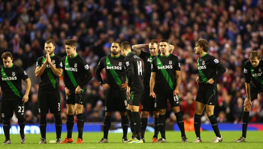 LIVERPOOL, ENGLAND - JANUARY 26:  Stoek City players react during the penalty shoot out during the Capital One Cup semi final second leg match between Liverpool and Stoke City at Anfield on January 26, 2016 in Liverpool, England.  (Photo by Clive Brunskill/Getty Images)