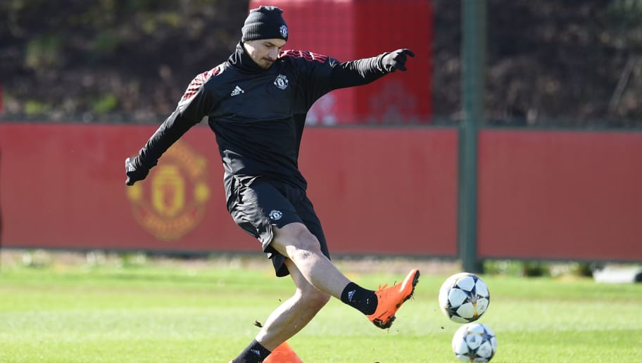 Manchester United's Swedish striker Zlatan Ibrahimovic kicks the ball during a team training session at the club's training complex near Carrington, west of Manchester in north west England on February 20, 2018, on the eve of their UEFA Champions League round of 16 football match against Sevilla. / AFP PHOTO / Oli SCARFF        (Photo credit should read OLI SCARFF/AFP/Getty Images)