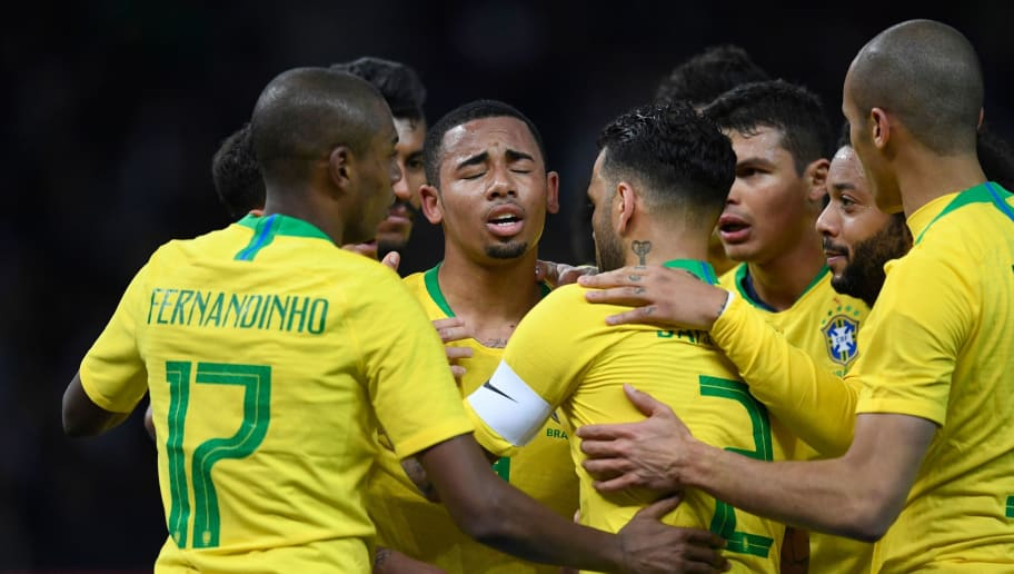 Brazil's team celebrates the goal scored by forward Gabriel Jesus (C) during the international friendly football match between Germany and Brazil in Berlin, on March 27, 2018. / AFP PHOTO / ROBERT MICHAEL        (Photo credit should read ROBERT MICHAEL/AFP/Getty Images)