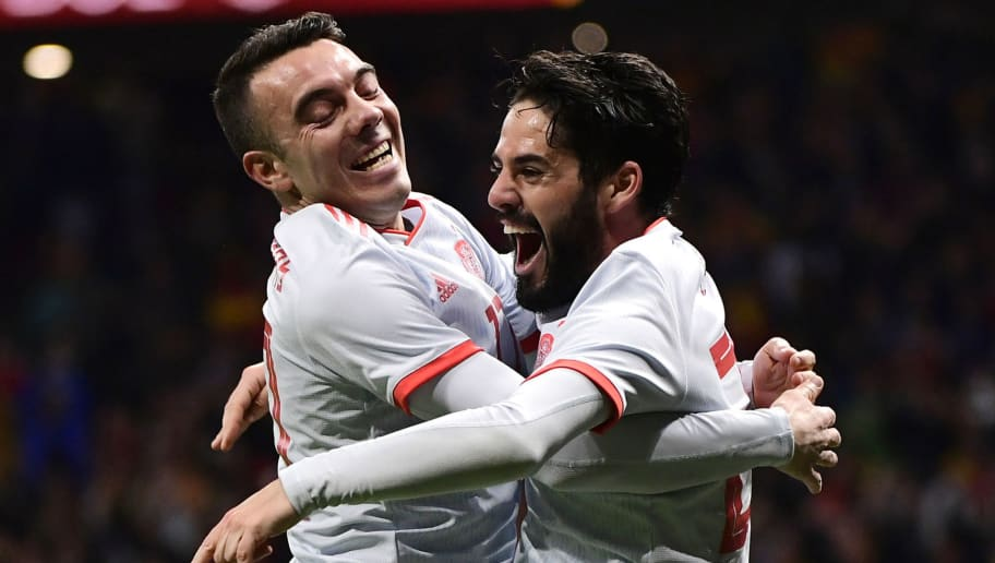 Spain's midfielder Isco (R) celebrates with Spain's forward Iago Aspas after scoring his team's third goal during a friendly football match between Spain and Argentina at the Wanda Metropolitano Stadium in Madrid on March 27, 2018. / AFP PHOTO / PIERRE-PHILIPPE MARCOU        (Photo credit should read PIERRE-PHILIPPE MARCOU/AFP/Getty Images)