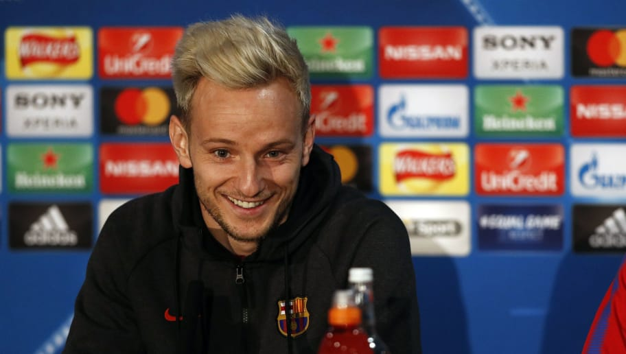 Barcelona's Croatian midfielder Ivan Rakitic gestures during a press conference at Stamford Bridge stadium in London on February 19, 2018, on the eve of their UEFA Champions League round of 16 football match against Chelsea. / AFP PHOTO / ADRIAN DENNIS        (Photo credit should read ADRIAN DENNIS/AFP/Getty Images)