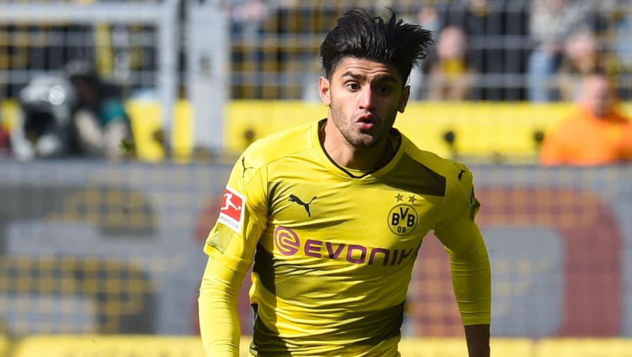 Dortmund's German midfielder Mahmoud Dahoud plays the ball during the German first division Bundesliga football match Borussia Dortmund vs Hanover 96, in Dortmund, western Germany, on March 18, 2018. / AFP PHOTO / Patrik STOLLARZ / RESTRICTIONS: DURING MATCH TIME: DFL RULES TO LIMIT THE ONLINE USAGE TO 15 PICTURES PER MATCH AND FORBID IMAGE SEQUENCES TO SIMULATE VIDEO. == RESTRICTED TO EDITORIAL USE == FOR FURTHER QUERIES PLEASE CONTACT DFL DIRECTLY AT + 49 69 650050         (Photo credit should read PATRIK STOLLARZ/AFP/Getty Images)