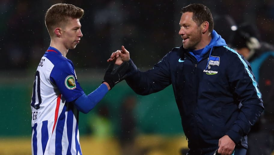 HEIDENHEIM, GERMANY - FEBRUARY 10:  Head coach Pal Dardai of Berlin hugs Mitchell Weiser after the DFB Cup Quarter Final match between 1. FC Heidenheim and Hertha BSC Berlin at Voith-Arena on February 10, 2016 in Heidenheim, Germany.  (Photo by Alex Grimm/Bongarts/Getty Images)