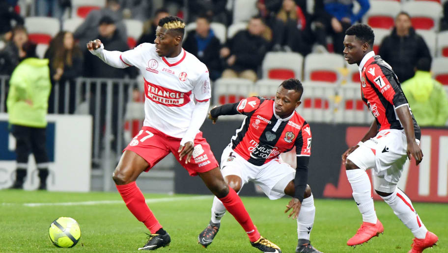 Toulouse's Ivory Coast  midfielder Ibrahim Sangare (L) vies with Nice's Ivorian midfielder Jean-Michael Seri during the French L1 football match Nice(OGCN) vs Toulouse (TFC) on February 3, 2018 at the 'Allianz Riviera Stadium' in Nice. / AFP PHOTO / YANN COATSALIOU        (Photo credit should read YANN COATSALIOU/AFP/Getty Images)