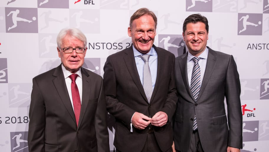 FRANKFURT AM MAIN, GERMANY - JANUARY 16: DFL League President Dr. Reinhard Rauball (L) poses with Hans-Joachim Watzke, CEO of Borussia Dortmund, and DFL CEO Christian Seifert (R) during the 2018 DFL New Year Reception at Thurn & Taxis Palais on January 16, 2018 in Frankfurt am Main, Germany. (Photo by Simon Hofmann/Bongarts/Getty Images)