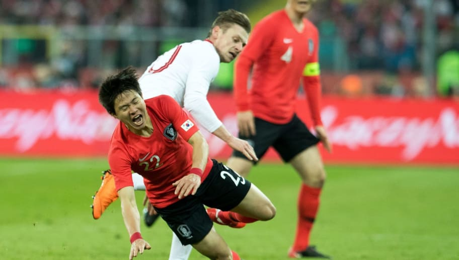 Poland's defender Lukasz Piszczek (R) vies for the ball with South Korea's midfielder Kwon Chang-hoon (L) during the international friendly football match between Poland and South Korea at the Silesian Stadium in Chorzow, Poland on March 27, 2018. / AFP PHOTO / ANDRZEJ IWANCZUK        (Photo credit should read ANDRZEJ IWANCZUK/AFP/Getty Images)
