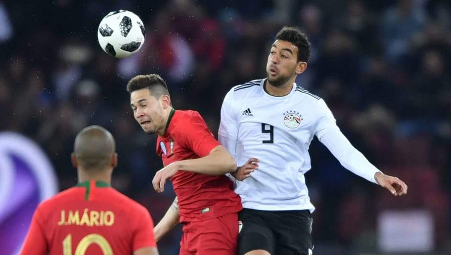 Portugal's defender Raphael Guerreiro (C) heads the ball next to Egypt's midfielder Hamed Hasan during their international friendly football match between Portugal and Egypt at Letzigrund stadium in Zurich on March 23, 2018. / AFP PHOTO / Fabrice COFFRINI        (Photo credit should read FABRICE COFFRINI/AFP/Getty Images)