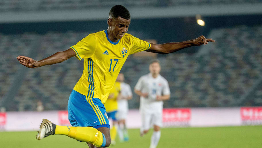 Picture taken on January 12, 2017 shows Swedish football player Alexander Isak during a friendly football match between Sweden and Slovaka at Zayed Sports City Stadium in Abu Dhabi. Swedish football prodigy Alexander Isak -- dubbed the next Zlatan Ibrahimovic -- is on the verge of signing with German first division Bundesliga club Borussia Dortmund, snubbing an offer from Real Madrid, Swedish daily Aftonbladet reported on January 21, 2017. / AFP PHOTO / TT News Agency / Adam IHSE / Sweden OUT        (Photo credit should read ADAM IHSE/AFP/Getty Images)