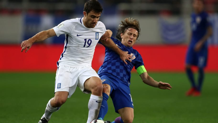 PIRAEUS, GREECE - NOVEMBER 12: Sokratis Papastathopoulos of Greece and Luka Modric of Croatia during the FIFA 2018 World Cup Qualifier Play-Off: Second Leg between Greece and Croatia at Karaiskakis Stadium on November 12, 2017 in Piraeus, Greece. (Photo by Catherine Ivill/Getty Images)
