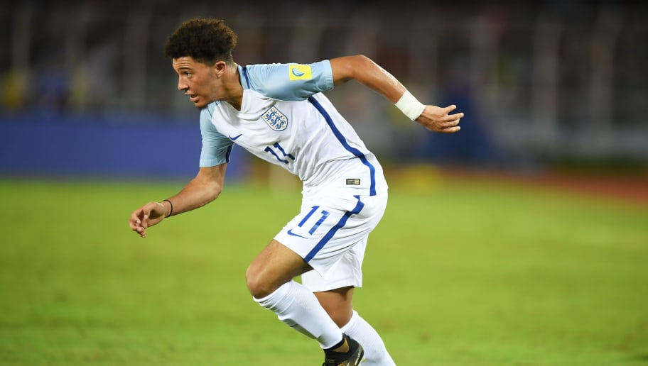 England's Jadon Sancho runs with the ball during the group stage football match between England and Chile in the FIFA U-17 World Cup at the Salt Lake Stadium in Kolkata on October 8, 2017. / AFP PHOTO / Dibyangshu SARKAR        (Photo credit should read DIBYANGSHU SARKAR/AFP/Getty Images)