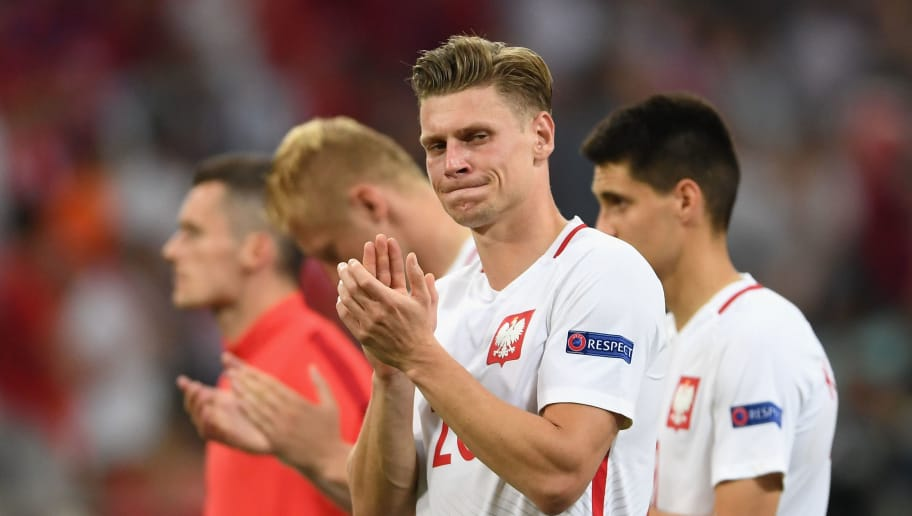 MARSEILLE, FRANCE - JUNE 30:  Lukasz Piszczek and Poland applaud their supporters after their team's defeat through the penalty shootout in the UEFA EURO 2016 quarter final match between Poland and Portugal at Stade Velodrome on June 30, 2016 in Marseille, France.  (Photo by Laurence Griffiths/Getty Images)