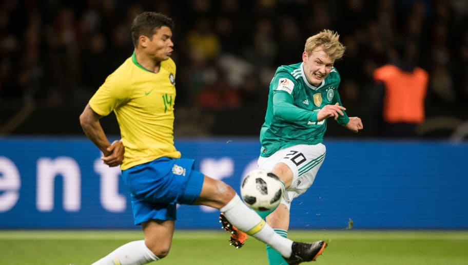 Germany's midfielder Julian Brandt (R) and Brazil's defender Thiago Silva vie for the ball during the international friendly football match between Germany and Brazil in Berlin, on March 27, 2018. / AFP PHOTO / ROBERT MICHAEL        (Photo credit should read ROBERT MICHAEL/AFP/Getty Images)
