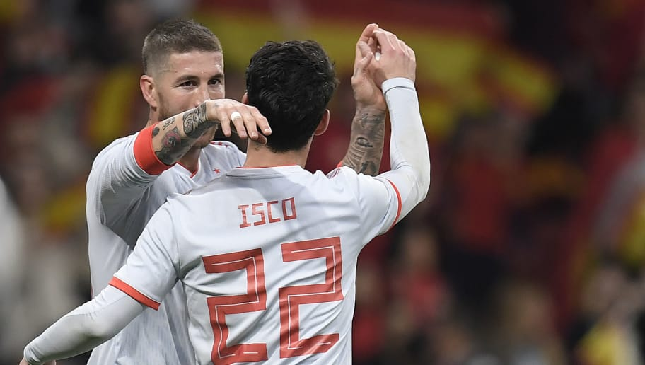 Spain's midfielder Isco (R) celebrates with Spain's defender Sergio Ramos after scoring a goal during a friendly football match between Spain and Argentina at the Wanda Metropolitano Stadium in Madrid on March 27, 2018. / AFP PHOTO / GABRIEL BOUYS        (Photo credit should read GABRIEL BOUYS/AFP/Getty Images)
