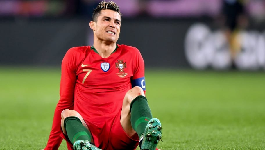Portugal's forward Cristiano Ronaldo reacts during the international friendly football match between Portugal and Netherlands at Stade de Geneve stadium in Geneva on March 26, 2018. / AFP PHOTO / Fabrice COFFRINI        (Photo credit should read FABRICE COFFRINI/AFP/Getty Images)