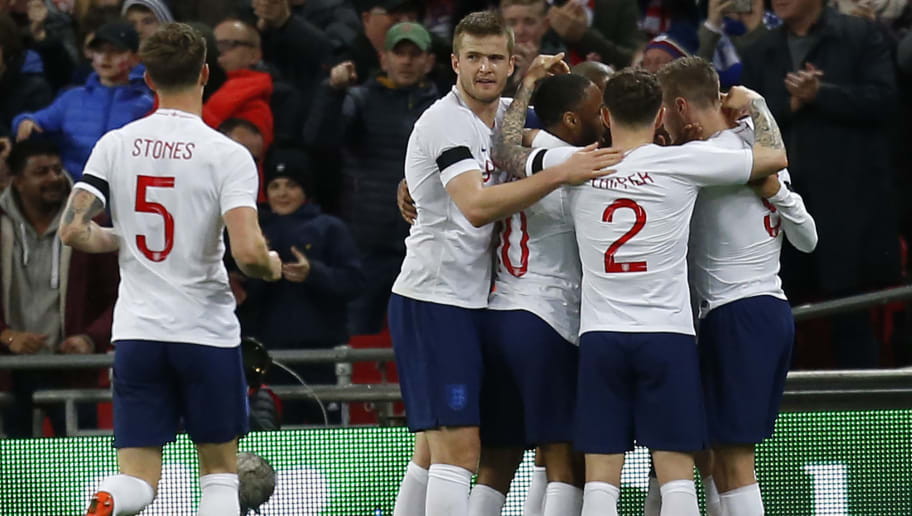 England's striker Jamie Vardy (R) celebrates with teammates after scoring the opening goal of the International friendly football match between England and Italy at Wembley stadium in London on March 27, 2018. The game finished 1-1. / AFP PHOTO / Ian KINGTON        (Photo credit should read IAN KINGTON/AFP/Getty Images)
