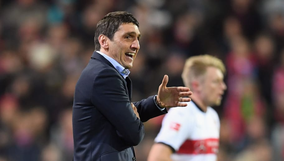 FREIBURG IM BREISGAU, GERMANY - MARCH 16:  Head coach Tayfun Korkut of Stuttgart reacts during the Bundesliga match between Sport-Club Freiburg and VfB Stuttgart at Schwarzwald-Stadion on March 16, 2018 in Freiburg im Breisgau, Germany.  (Photo by Matthias Hangst/Bongarts/Getty Images)