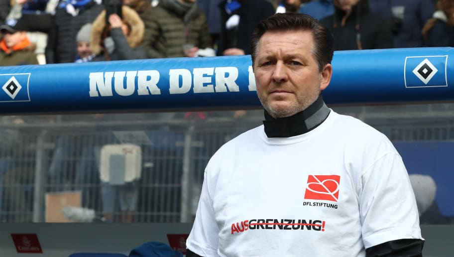 HAMBURG, GERMANY - MARCH 17:  Head coach Christian Titz of Hamburg wear shirts with the slogans of the DFL Foundation against discrimination prior to the Bundesliga match between Hamburger SV and Hertha BSC at Volksparkstadion on March 17, 2018 in Hamburg, Germany.  (Photo by Oliver Hardt/Bongarts/Getty Images)