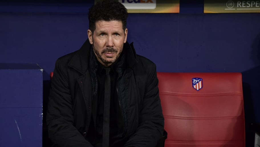 Atletico Madrid's Argentinian coach Diego Simeone sits on the bench before the Europa League Round of 16 first leg football match between Club Atletico de Madrid and FC Lokomotiv Moscow at the Wanda Metropolitano stadium in Madrid on March 8, 2018. / AFP PHOTO / JAVIER SORIANO        (Photo credit should read JAVIER SORIANO/AFP/Getty Images)