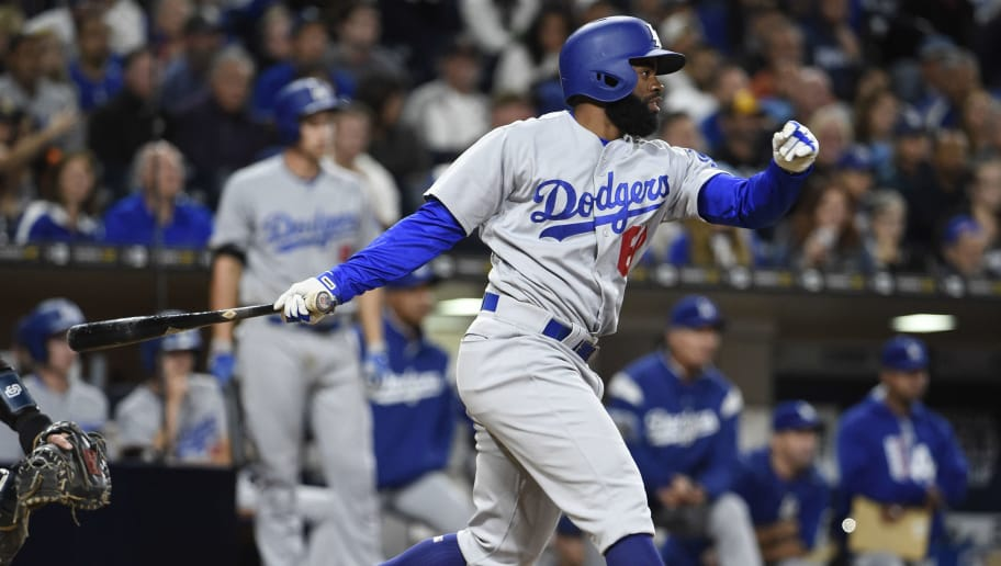 SAN DIEGO, CA - MAY 5: Andrew Toles #60 of the Los Angeles Dodgers hits an RBI double during the seventh inning of a baseball game against the San Diego Padres at PETCO Park on May 5, 2017 in San Diego, California.  (Photo by Denis Poroy/Getty Images)