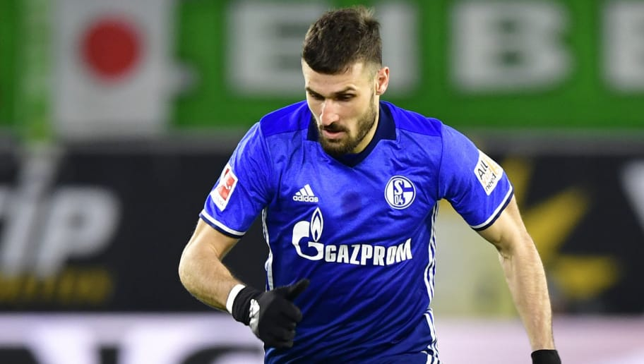 Schalke's German midfielder Daniel Caligiuri runs with the ball during the German First division Bundesliga football match VfL Wolfsburg vs Schalke 04, in Wolfsburg, on March 17, 2018. / AFP PHOTO / John MACDOUGALL / RESTRICTIONS: DURING MATCH TIME: DFL RULES TO LIMIT THE ONLINE USAGE TO 15 PICTURES PER MATCH AND FORBID IMAGE SEQUENCES TO SIMULATE VIDEO. == RESTRICTED TO EDITORIAL USE == FOR FURTHER QUERIES PLEASE CONTACT DFL DIRECTLY AT + 49 69 650050  / RESTRICTIONS: DURING MATCH TIME: DFL RULES TO LIMIT THE ONLINE USAGE TO 15 PICTURES PER MATCH AND FORBID IMAGE SEQUENCES TO SIMULATE VIDEO. == RESTRICTED TO EDITORIAL USE == FOR FURTHER QUERIES PLEASE CONTACT DFL DIRECTLY AT + 49 69 650050        (Photo credit should read JOHN MACDOUGALL/AFP/Getty Images)