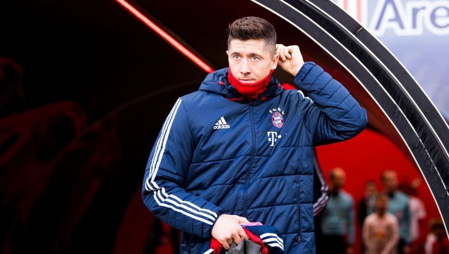 Bayern Munich's Polish forward Robert Lewandowski arrives prior to the German first division Bundesliga football match between RB Leipzig and FC Bayern Munich in Leipzig, eastern Germany on March 18, 2018.  / AFP PHOTO / ROBERT MICHAEL / RESTRICTIONS: DURING MATCH TIME: DFL RULES TO LIMIT THE ONLINE USAGE TO 15 PICTURES PER MATCH AND FORBID IMAGE SEQUENCES TO SIMULATE VIDEO. == RESTRICTED TO EDITORIAL USE == FOR FURTHER QUERIES PLEASE CONTACT DFL DIRECTLY AT + 49 69 650050  / RESTRICTIONS: DURING MATCH TIME: DFL RULES TO LIMIT THE ONLINE USAGE TO 15 PICTURES PER MATCH AND FORBID IMAGE SEQUENCES TO SIMULATE VIDEO. == RESTRICTED TO EDITORIAL USE == FOR FURTHER QUERIES PLEASE CONTACT DFL DIRECTLY AT + 49 69 650050        (Photo credit should read ROBERT MICHAEL/AFP/Getty Images)