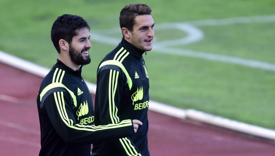 Spain's midfielder Isco (L) and Spain's midfielder Koke arrive to take part in a training session at the Sport City training ground in Las Rozas, near Madrid on March 25, 2015, ahead of the EURO 2016 qualifiers football match against Ukraine.   AFP PHOTO/ JAVIER SORIANO        (Photo credit should read JAVIER SORIANO/AFP/Getty Images)